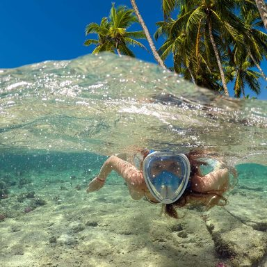 snorkeling-near-a-tropical-island-beautiful-girl-s-D47532M